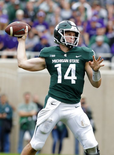 (AP Photo/Al Goldis). Michigan State quarterback Brian Lewerke throws a pass against Northwestern during the second quarter of an NCAA college football game, Saturday, Oct. 6, 2018, in East Lansing, Mich.