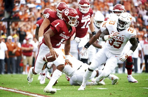 (AP Photo/Cooper Neill). Oklahoma quarterback Kyler Murray (1) scrambles against Texas during the first half of an NCAA college football game at the Cotton Bowl, Saturday, Oct. 6, 2018, in Dallas.
