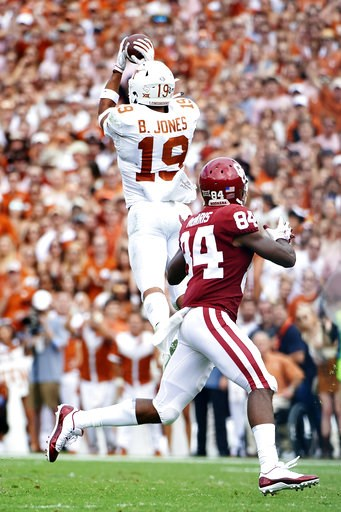 (AP Photo/Cooper Neill). Texas defensive back Brandon Jones (19) intercepts a pass thrown by Oklahoma quarterback Kyler Murray (1) during the first half of an NCAA college football game at the Cotton Bowl, Saturday, Oct. 6, 2018, in Dallas.