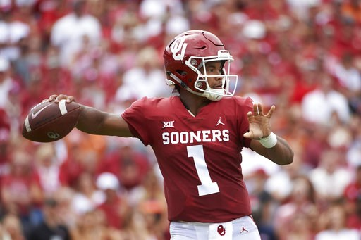 (AP Photo/Cooper Neill). Oklahoma quarterback Kyler Murray (1) throws a pass against Texas during the first half of an NCAA college football game at the Cotton Bowl, Saturday, Oct. 6, 2018, in Dallas.