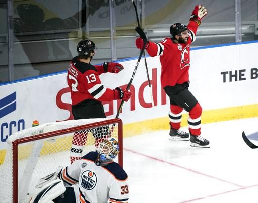 (Bjorn Larsson Rosvall /TT News Agency via AP). New Jersey Devils' Kyle Palmieri celebrates scoring during the season-opening NHL Global Series hockey match between Edmonton Oilers and New Jersey Devils at Scandinavium in Gothenburg, Sweden, Saturday, ...