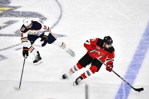 (Bjorn Larsson Rosvall /TT News Agency via AP). Edmonton Oilers Jujhar Khaira, left and New Jersey Devils Will Butcher vie for the puck, during the season-opening NHL Global Series hockey match between Edmonton Oilers and New Jersey Devils at Scandinav...