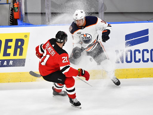 (Bjorn Larsson Rosvall /TT News Agency via AP). New Jersey Devils' Kyle Palmieri, left and Edmonton Oilers' Ryan Strome vie for the puck, during the season-opening NHL Global Series hockey match between Edmonton Oilers and New Jersey Devils at Scandina...