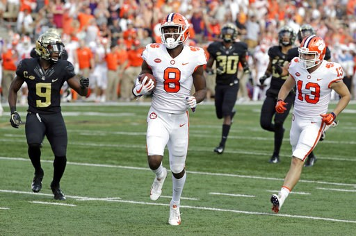 (AP Photo/Chuck Burton). Clemson's Justyn Ross (8) runs past Wake Forest's Chuck Wade Jr. (9) for a touchdown during the first half of an NCAA college football game in Charlotte, N.C., Saturday, Oct. 6, 2018.