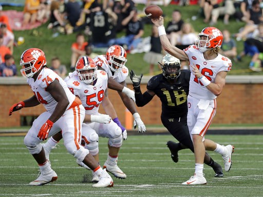 (AP Photo/Chuck Burton). Clemson's Trevor Lawrence (16) throws a pass against Wake Forest during the first half of an NCAA college football game in Charlotte, N.C., Saturday, Oct. 6, 2018.