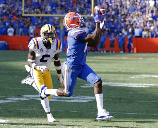 (AP Photo/John Raoux). Florida wide receiver Josh Hammond, right, catches a 35-yard pass in front of LSU cornerback Kary Vincent Jr., left, to set up a Florida touchdown in the first half of an NCAA college football game, Saturday, Oct. 6, 2018, in Gai...