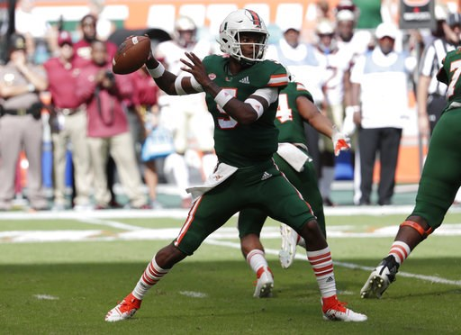 (AP Photo/Lynne Sladky). Miami quarterback N'Kosi Perry stands back to pass during the first half of an NCAA college football game against Florida State, Saturday, Oct. 6, 2018, in Miami Gardens, Fla.
