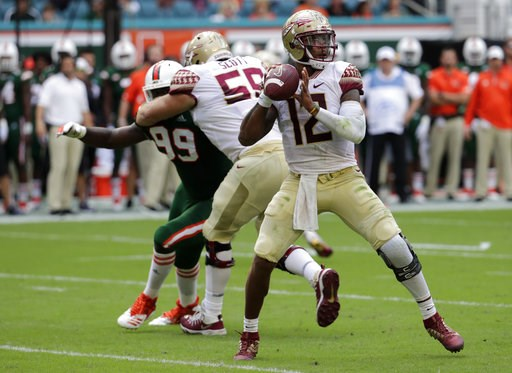 (AP Photo/Lynne Sladky). Florida State quarterback Deondre Francois (12) stands back to pass during the first half of an NCAA college football game against Miami, Saturday, Oct. 6, 2018, in Miami Gardens, Fla.