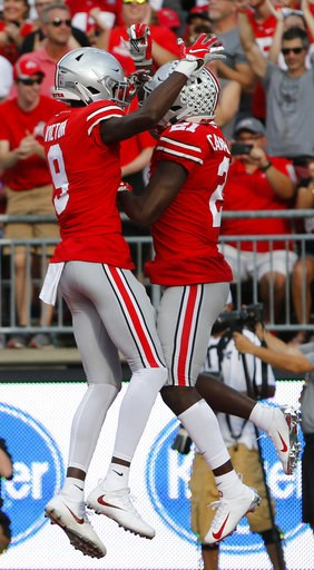 (AP Photo/Jay LaPrete). Ohio State receiver Parris Campbell, right, celebrates his touchdown against Indiana with Binjimen Victor during the first half of an NCAA college football game Saturday, Oct. 6, 2018, in Columbus, Ohio.