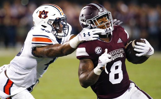 (AP Photo/Rogelio V. Solis). Mississippi State running back Kylin Hill (8) breaks away from a attempted tackle by Auburn linebacker Darrell Williams (49) as he runs for a first down during the first half of their NCAA college football game in Starkvill...