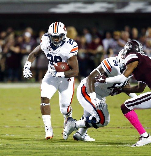 (AP Photo/Rogelio V. Solis). Auburn running back JaTarvious Whitlow (28) picks up yards against Mississippi State during the first half of their NCAA college football game in Starkville, Miss., Saturday, Oct. 6 2018.