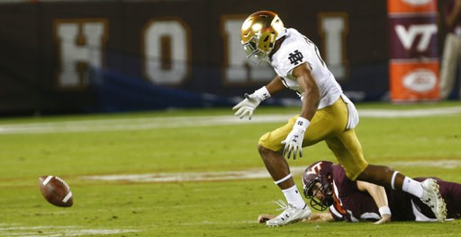 (AP Photo/Steve Helber). Notre Dame cornerback Julian Love (27) heads for the fumble as Virginia Tech quarterback Ryan Willis (5) watches during the first half of an NCAA college football game in Blacksburg, Va., Saturday, Oct. 6, 2018. Love recovered ...