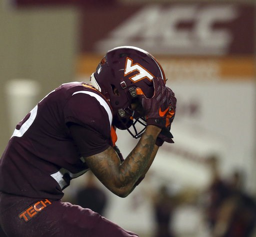 (Matt Gentry/The Roanoke Times via AP). Virginia Tech defensive back Jovonn Quillen reacts after missing an interception opportunity during the first half of an NCAA college football game against Notre Dame on Saturday, Oct. 6, 2018, in Blacksburg, Va.