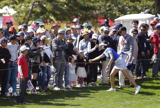 (AP Photo/Ahn Young-joon). In Gee Chun of South Korea is greeted by the gallery on the sixth hole during the final round of the LPGA's UL International Crown golf tournament at the Jack Nicklaus Golf Club Korea in Incheon, South Korea, Sunday, Oct. 7, ...