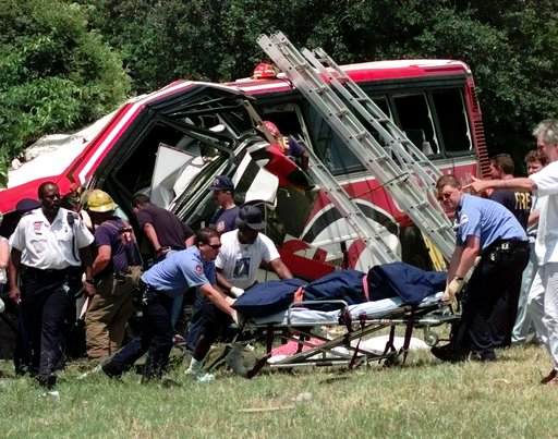(AP Photo/Bill Haber, File). FILE - In this May 9, 1999, file photo, emergency workers remove the body of one of the victims of a bus crash in New Orleans, where a chartered bus carrying members of a casino club on a Mother's Day gambling excursion ran...