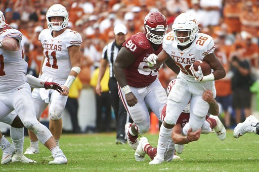 (AP Photo/Cooper Neill). Texas running back Keaontay Ingram (26) breaks free against Oklahoma during the second half of an NCAA college football game at the Cotton Bowl, Saturday, Oct. 6, 2018, in Dallas.