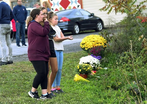 (AP Photo/Hans Pennink). Friends of victims that died in a fatal limousine crash comfort each other after placing flowers at the intersection in Schoharie, N.Y., Sunday, Oct. 7, 2018. A limousine loaded with revelers headed to a 30th birthday party ble...