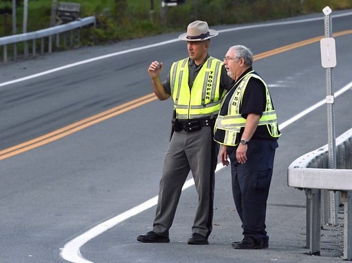 (AP Photo/Hans Pennink). A New York state trooper and a member of the National Transportation Safety Board view the scene of Saturday's fatal crash in Schoharie, N.Y., Sunday, Oct. 7, 2018. A limousine loaded with revelers headed to a 30th birthday par...