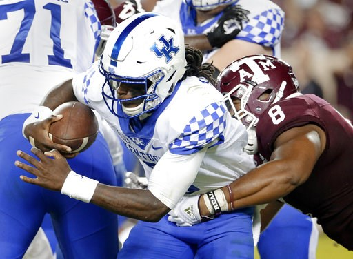 (AP Photo/Michael Wyke). Kentucky quarterback Terry Wilson (3) is sacked by Texas A&M defensive lineman Kingsley Keke (8) during the second half of an NCAA college football game Saturday, Oct. 6, 2018, in College Station, Texas.