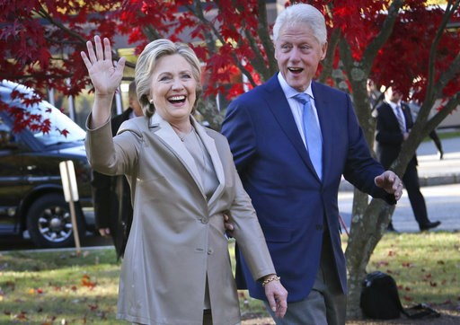 (AP Photo/Seth Wenig, File). FILE - In this Nov. 8, 2016, file photo, Democratic presidential candidate Hillary Clinton, and her husband former President Bill Clinton, greet supporters after voting in Chappaqua, N.Y. The Clintons announced Monday, Oct....