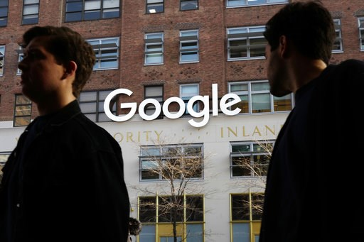 (AP Photo/Mark Lennihan, File). FILE - In this Dec. 4, 2017 file photo, people walk by Google offices in New York. Google is closing the consumer version of its long-spurned Plus social network after discovering a bug earlier this year that leaked some...