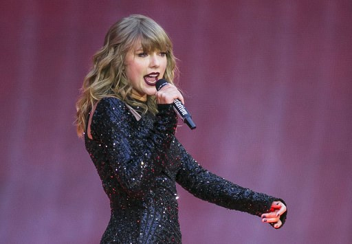 (Photo by Joel C Ryan/Invision/AP, File). FILE - In this June 22, 2018, file photo, singer Taylor Swift performs on stage in concert at Wembley Stadium in London. Swift  posted on Instagram Sunday, Oct. 7, that she's voting for Tennessee's Democratic S...
