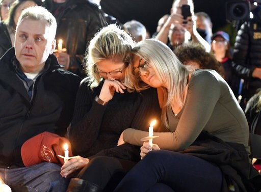 (AP Photo/Hans Pennink). Family members and friends gather for a candlelight vigil memorial at Mohawk Valley Gateway Overlook Pedestrian Bridge in Amsterdam, N.Y., Monday, Oct. 8, 2018. The memorial honored 20 people who died in Saturday's fatal limous...