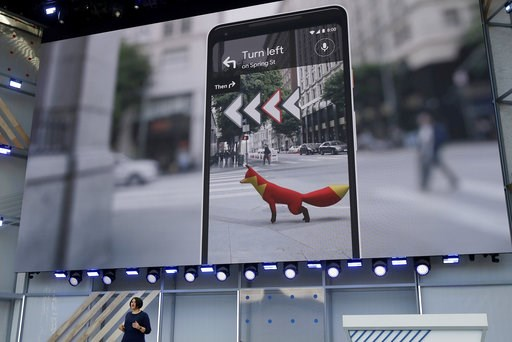 (AP Photo/Jeff Chiu, File). FILE - In this May 8, 2018 file photo, Google's Aparna Chennapragada speaks at the Google I/O conference in Mountain View, Calif. Google is expected to introduce two new smartphones in its relentless push to increase the usa...