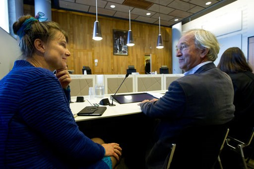 (AP Photo/Peter Dejong). Urgenda director Marjan Minnesma, left, waits for judges to enter the appeals court in The Hague, Netherlands, Tuesday, Oct. 9, 2018, where the Dutch government appealed a 2015 landmark ruling ordering the government to cut the...