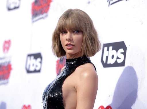 (Photo by Richard Shotwell/Invision/AP, File). FILE - In this April 3, 2016 file photo, Taylor Swift arrives at the iHeartRadio Music Awards at The Forum in Inglewood, Calif. Swift jumped into a contentious midterm political race with a rare endorsemen...