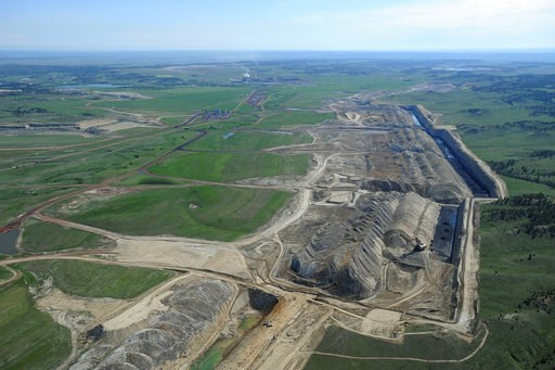 (Larry Mayer/The Billings Gazette via AP, File). FILE - This file photo taken May 25, 2013, shows an aerial view of Colstrip power plants 1,2,3 & 4 and the Westmoreland coal mines near Colstrip, Mont. Westmoreland Coal Co. of Englewood, Colo., file...
