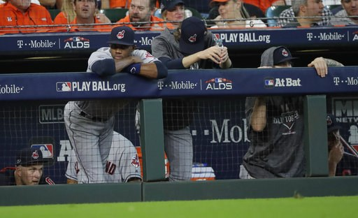 (AP Photo/David J. Phillip, File). FILE - In this Oct. 5, 2018, file photo, Cleveland Indians players watch from the dugout during the ninth inning  of their 7-2 loss in Game 1 of an American League Division Series baseball game against the Houston Ast...