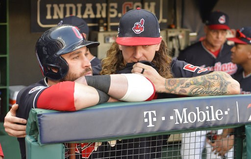 (AP Photo/Phil Long). Cleveland Indians' Jason Kipnis, left, is hugged by starting pitcher Mike Clevinger after the Houston Astros defeated the Indians 11-3 in Game 3 of a baseball American League Division Series, Monday, Oct. 8, 2018, in Cleveland.