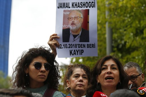 (AP Photo/Lefteris Pitarakis). Activists, members of the Human Rights Association Istanbul branch, holding posters with photos of missing Saudi journalist Jamal Khashoggi, talk to members of the media, during a protest in his support near the Saudi Ara...