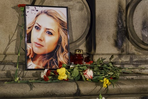 (AP Photo/Filip Dvorski). A portrait of slain television reporter Viktoria Marinova is placed on the Liberty Monument next to flowers and candles during a vigil in Ruse, Bulgaria, Tuesday, Oct. 9, 2018. Bulgarian police are investigating the rape, beat...