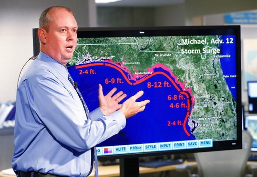 (AP Photo/Wilfredo Lee). National Hurricane Center director Ken Graham, gestures as he talks about storm surge during a televised update on the status of Hurricane Michael, Tuesday, Oct. 9, 2018, at the Hurricane Center in Miami. At least 120,000 peopl...