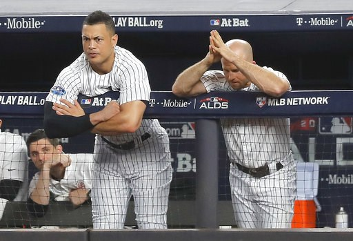 (AP Photo/Julie Jacobson). New York Yankees' Giancarlo Stanton, left, and Brett Gardner watch play from the dugout during the seventh inning of Game 4 of baseball's American League Division Series against the Boston Red Sox, Tuesday, Oct. 9, 2018, in N...