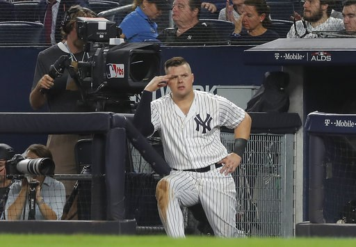(AP Photo/Julie Jacobson). New York Yankees' Luke Voit watches play from the dugout during the seventh inning of Game 4 of baseball's American League Division Series against the Boston Red Sox, Tuesday, Oct. 9, 2018, in New York.