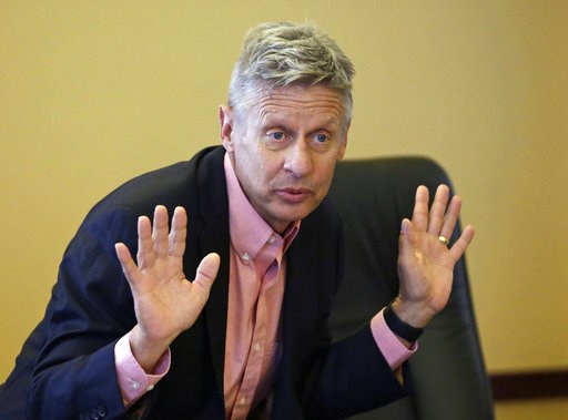 (AP Photo/Rick Bowmer, File). FILE - In this May 18, 2016, file photo, then-Libertarian presidential candidate and former New Mexico Gov. Gary Johnson speaks with legislators at the Utah State Capitol in Salt Lake City. Johnson wants to occupy a potent...