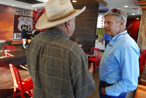 (AP Photo/Morgan Lee, File). FILE - In this Sept. 18, 2018, file photo, Libertarian U.S. Senate candidate Gary Johnson, right, talks with disabled military veteran Henry Pacheco during a campaign stop in Tucumcari, N.M. Former governor of New Mexico an...