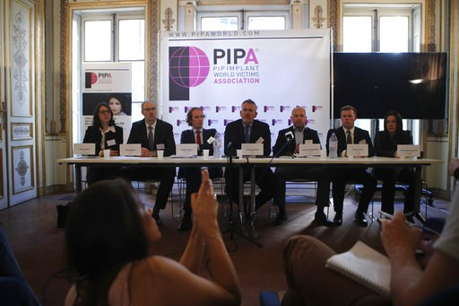 (AP Photo/Francois Mori). Lawyer Olivier Aumaitre, center, representing thousands of women with the PIP implants, speaks during a press conference in Paris, Wednesday, Oct.10, 2018. France's top court is ruling Wednesday in a case that may require some...