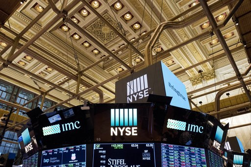 (AP Photo/Mark Lennihan, File). FILE- This Jan. 4, 2018, file photo shows the interior of the New York Stock Exchange. The U.S. stock market opens at 9:30 a.m. EDT on Wednesday, Oct. 10.