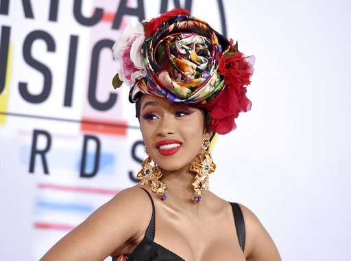 (Photo by Jordan Strauss/Invision/AP). Cardi B arrives at the American Music Awards on Tuesday, Oct. 9, 2018, at the Microsoft Theater in Los Angeles.