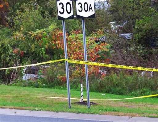 (Tom Heffernan Sr. via AP, File). FILE - In this Oct. 6, 2018, file photo, a limousine, left, has landed in the woods following a fatal crash in Schoharie, N.Y. Kim Lisinicchia tells CBS in an interview aired on Wednesday, Oct. 10, that her husband, Sc...