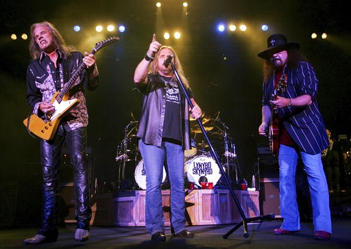 (AP Photo/John Russell). FILE - This May 27, 2005 file photo shows members of Lynyrd Skynyard, lead singer Johnny Van Zant, center, guitarists Rickey Medlocke, left, and Gary Rossington performing in Nashville, Tenn. A New York federal appeals court sa...