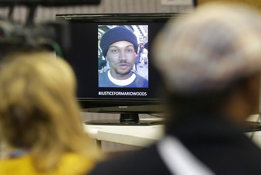 (AP Photo/Jeff Chiu, File). FILE - In this Dec. 11, 2015 file photo an image of Mario Woods, who was fatally shot by police, is shown on a monitor at a news conference at Southeast Community College in San Francisco. A federal judge says video of the r...