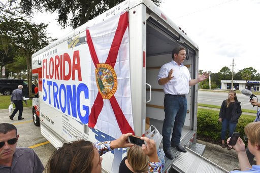 (Bob Self/The Florida Times-Union via AP). Florida gubernatorial candidate Ron DeSantis combined a campaign stop for supporters with a collection drive for water and canned goods for those in need after Hurricane Michael impending landfall at the Flori...