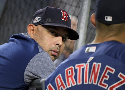 (AP Photo/Bill Kostroun). Boston Red Sox manager Alex Cora watches batting practice before Game 4 of baseball's American League Division Series against the New York Yankees, Tuesday, Oct. 9, 2018, in New York.