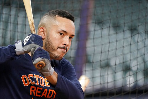 (AP Photo/David J. Phillip). Houston Astros' Carlos Correa waits to bat during a baseball workout Thursday, Oct. 4, 2018, in Houston. The Astros play the Cleveland Indians in Game 1 of the American League Division Series Friday.