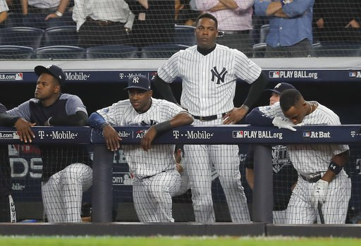 (AP Photo/Julie Jacobson). The New York Yankees watch from the dugout during the ninth inning of Game 4 of baseball's American League Division Series against the Boston Red Sox, Tuesday, Oct. 9, 2018, in New York.